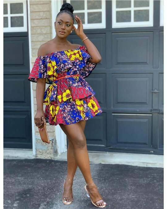 Linda Osifo in three tiered african print dress